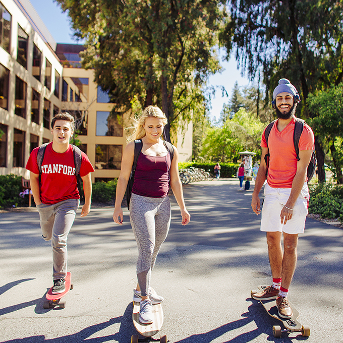 Three students on skateboards